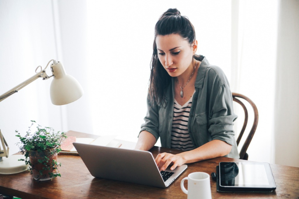young freelancer working at home picture id492679090 image
