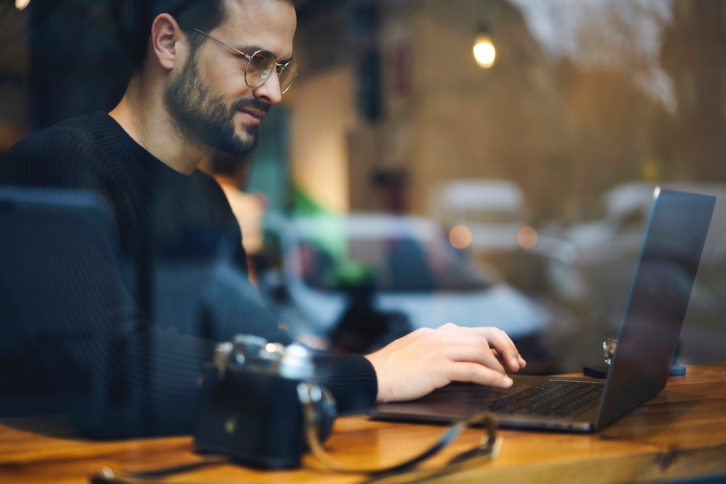 bearded entrepreneur male in glasses dressed in black sweater reading picture id905148386 image
