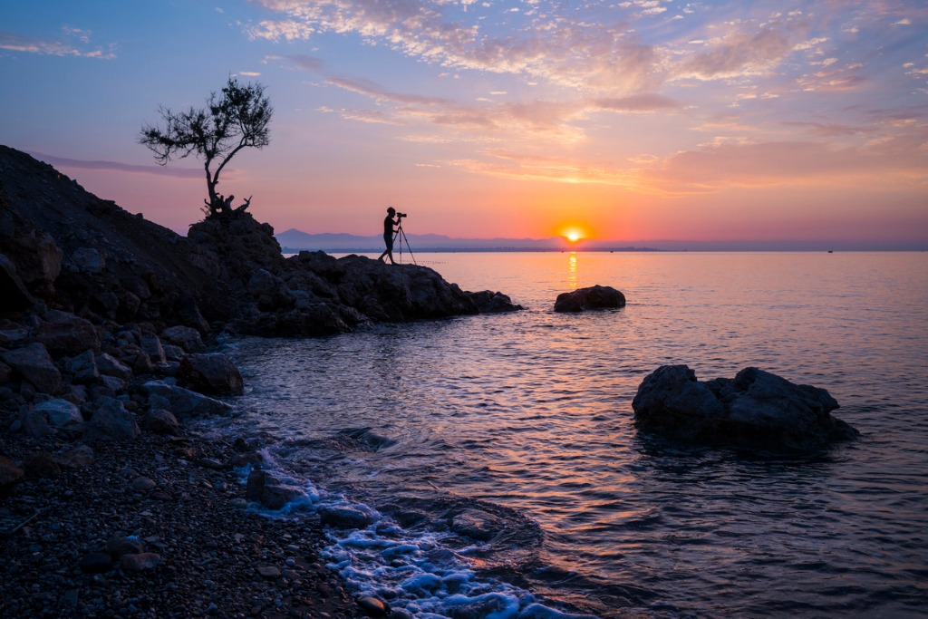 man photographing sunrise picture id913040736 image