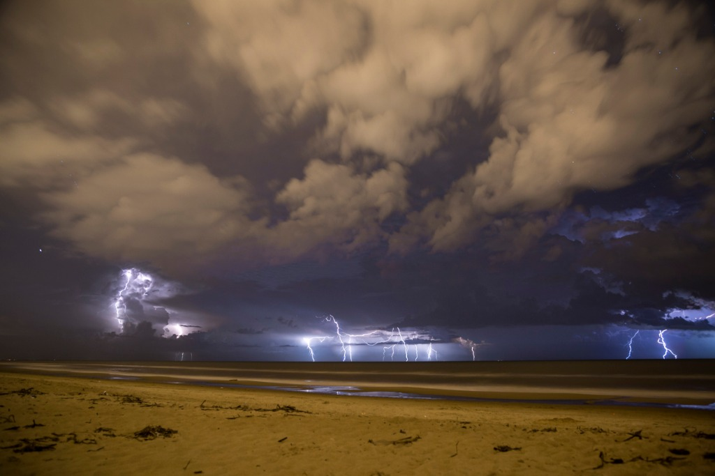 thunderstorm in the beach sand and clouds picture id515582753