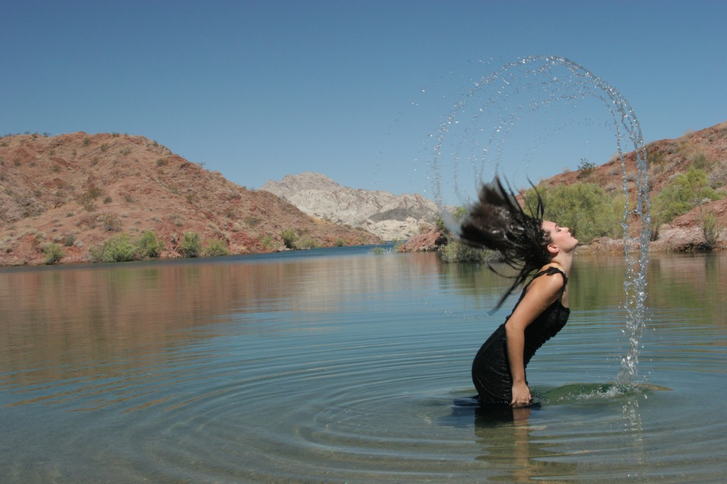 beautiful woman flipping hair in water picture id90843490 image