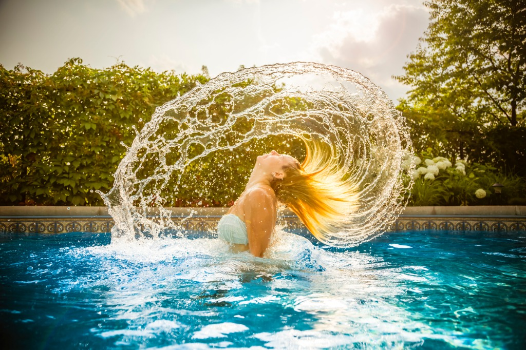young woman in water with hair splash picture id481566102 image