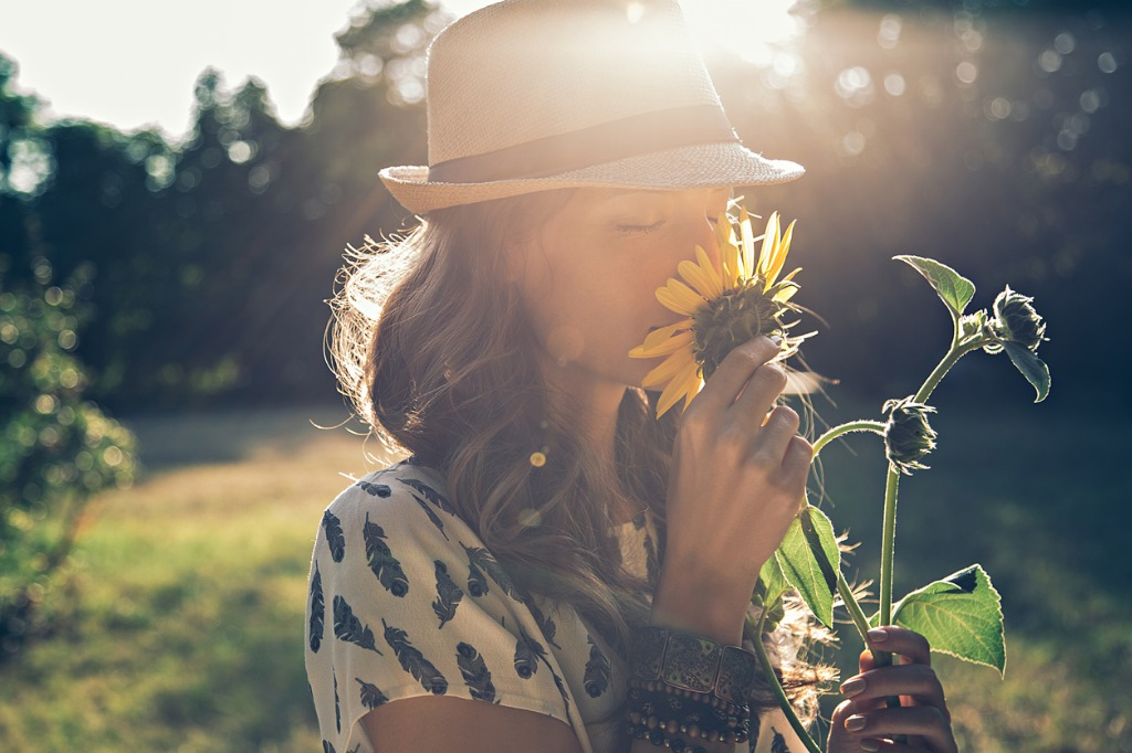 girl smells sunflower picture id513438122 image