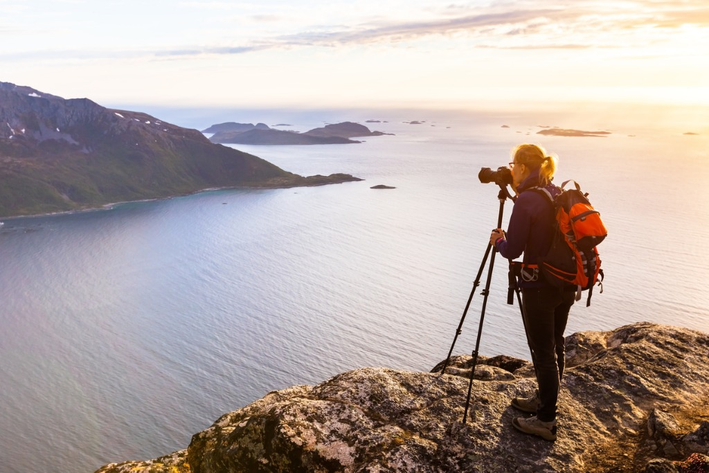 woman photographer photographing fjord in norway with dslr and tripod picture id804596000