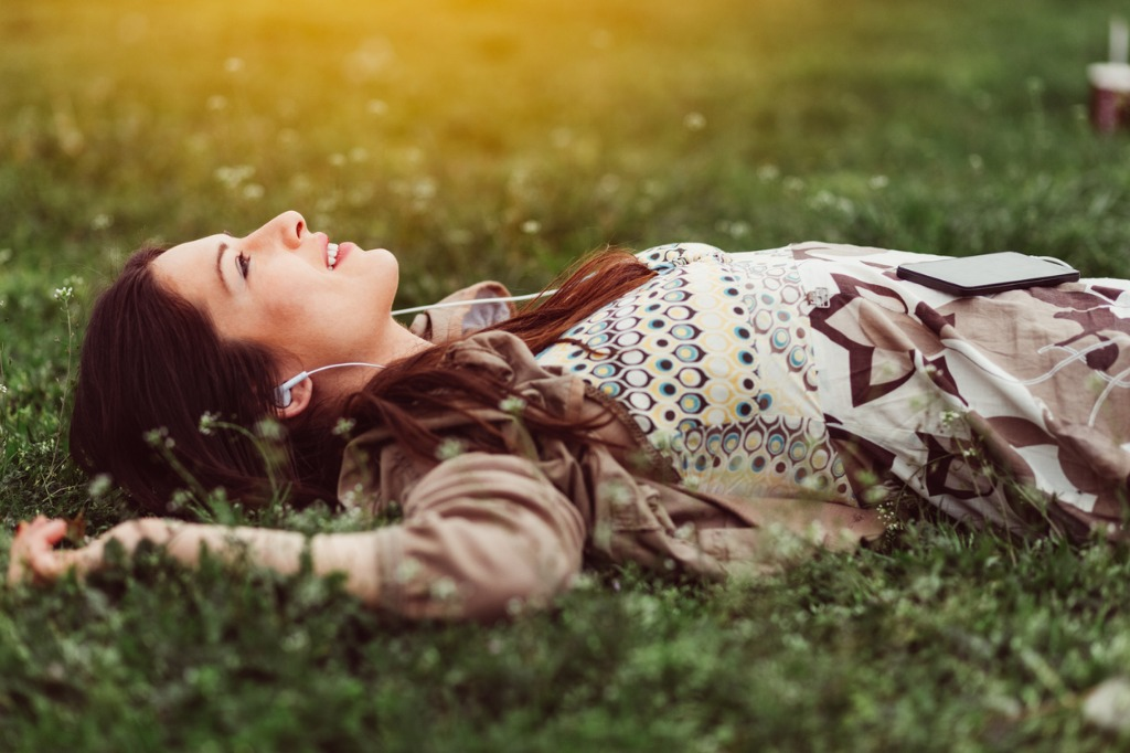 dreamy woman in the grass picture id640109210 image