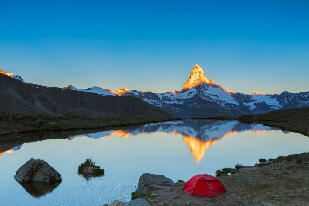 camping at matterhorn during sunrise with stellisee in foreground picture id655999512 image