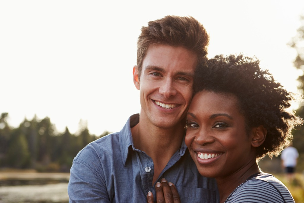 mixed race couple in the countryside looking to camera picture id540090684 image