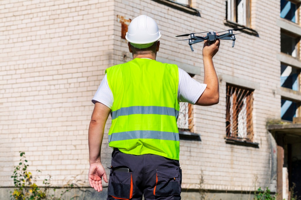 worker with drone before hand launch picture id857426390 image