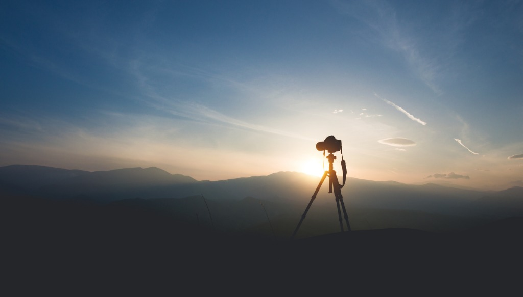 silhouette of a camera on a tripod picture id930934142 image