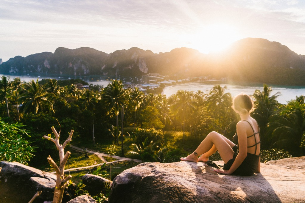 woman looking at view of koh phi phi at sunset picture id641112366 image