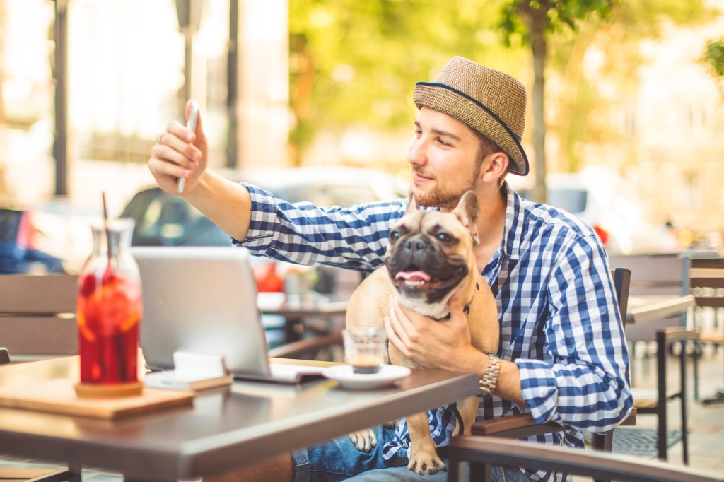 young man in the city with his french bulldog picture id927883346 image