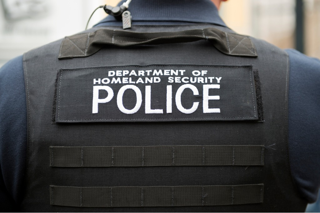 department of homeland security vest and officer picture id172449227 image