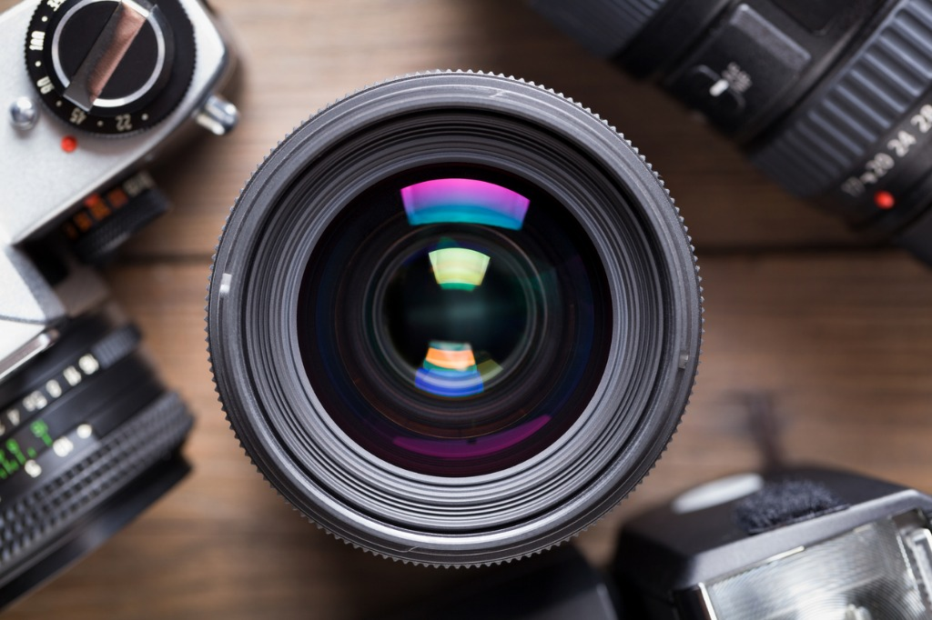 camera lens on wooden table picture id820499652 image