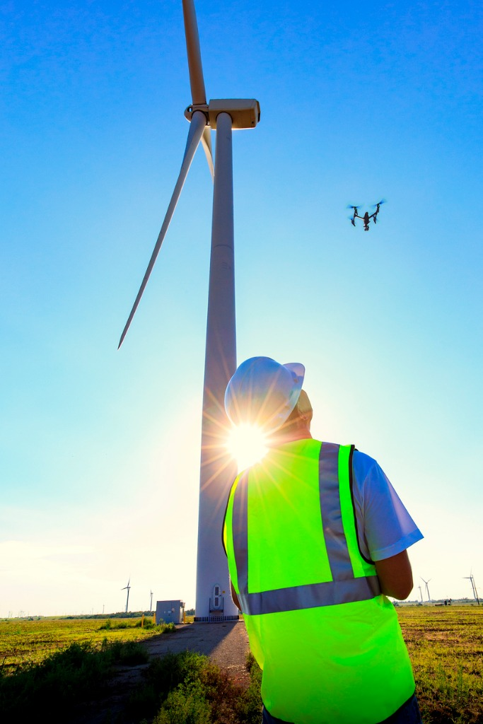 drone pilot operating uav during wind turbine inspection picture id878674616
