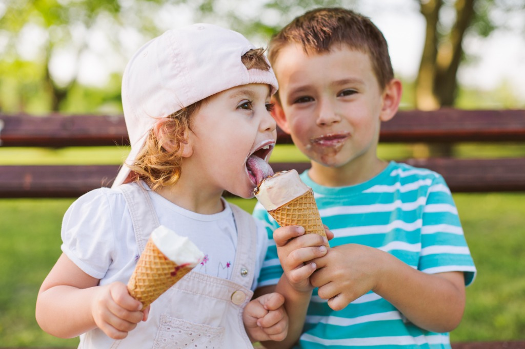 boy share ice cream with his sister picture id957740086 image