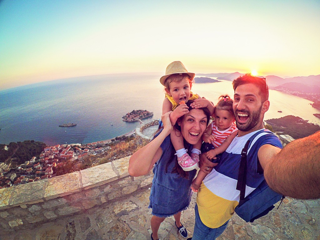 family with two little daughters travel in nature making selfie picture id873385094 image