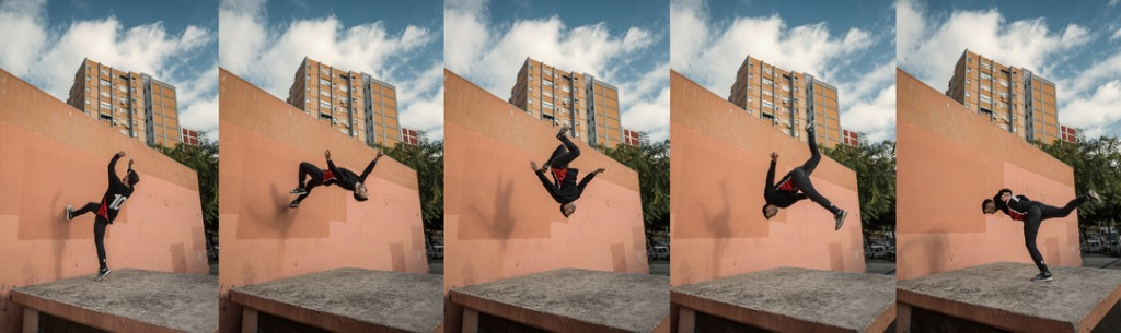 man jumping and doing backflips while practicing parkour in the city picture id891453154 image