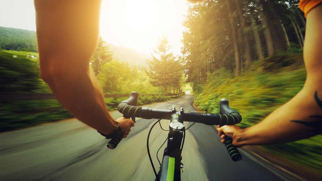 riding road racing bicycle on a mountain pass picture id814360694 image