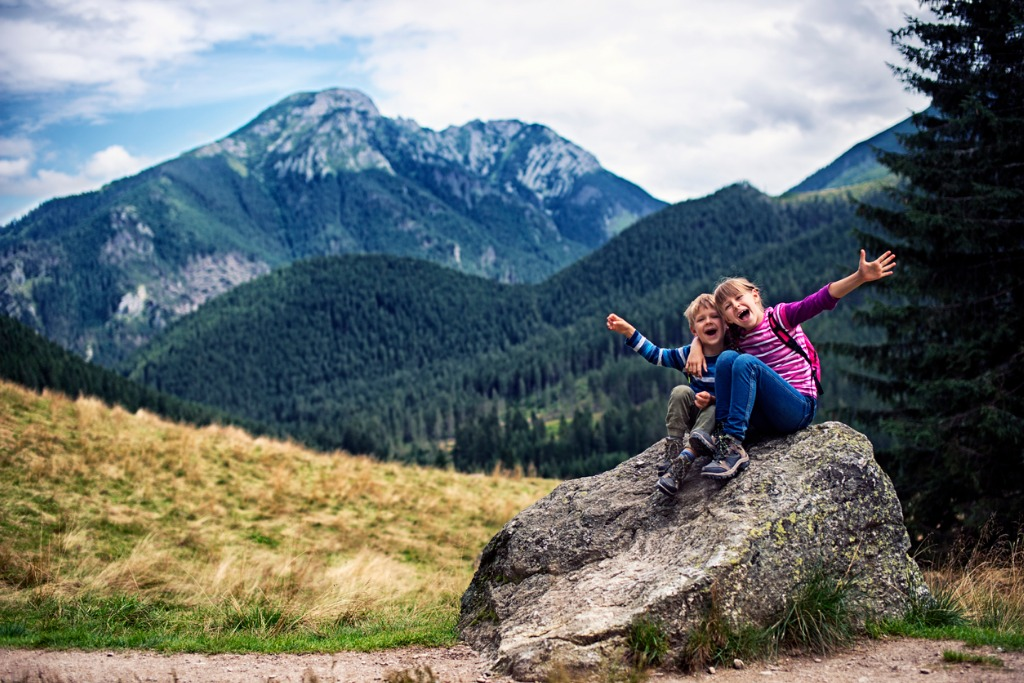 little hikers resting on big stone and posing picture id528616254 image