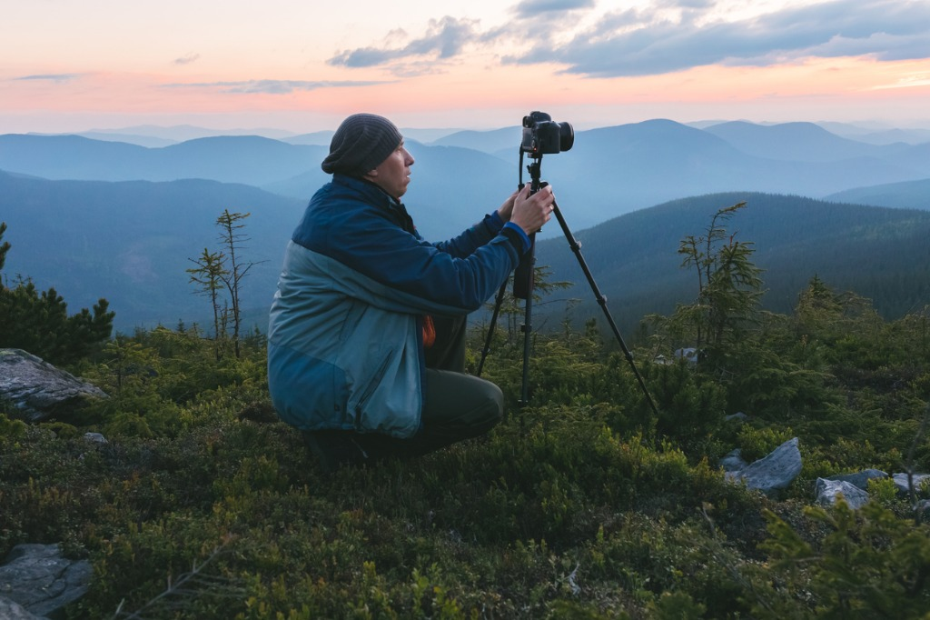 photographer shoots dawn in the mountains picture id1007477230 image