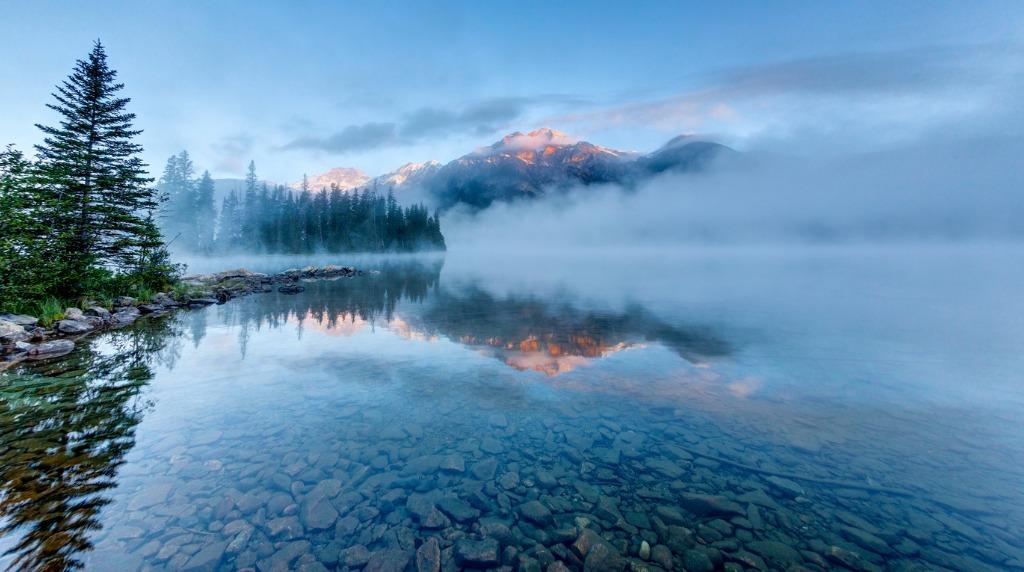 foggy sunrise at pyramid lake in jasper alberta canada picture id875490702 image