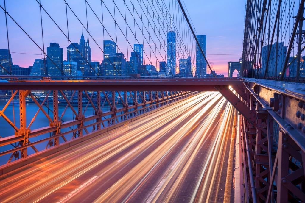 traffic on brooklyn bridge at dusk manhattan skyline new york picture id496434994 image
