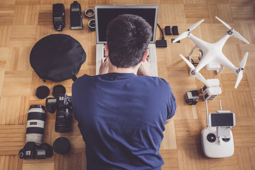 photographer with lots of equipment planning his next shoot picture id627718488 image