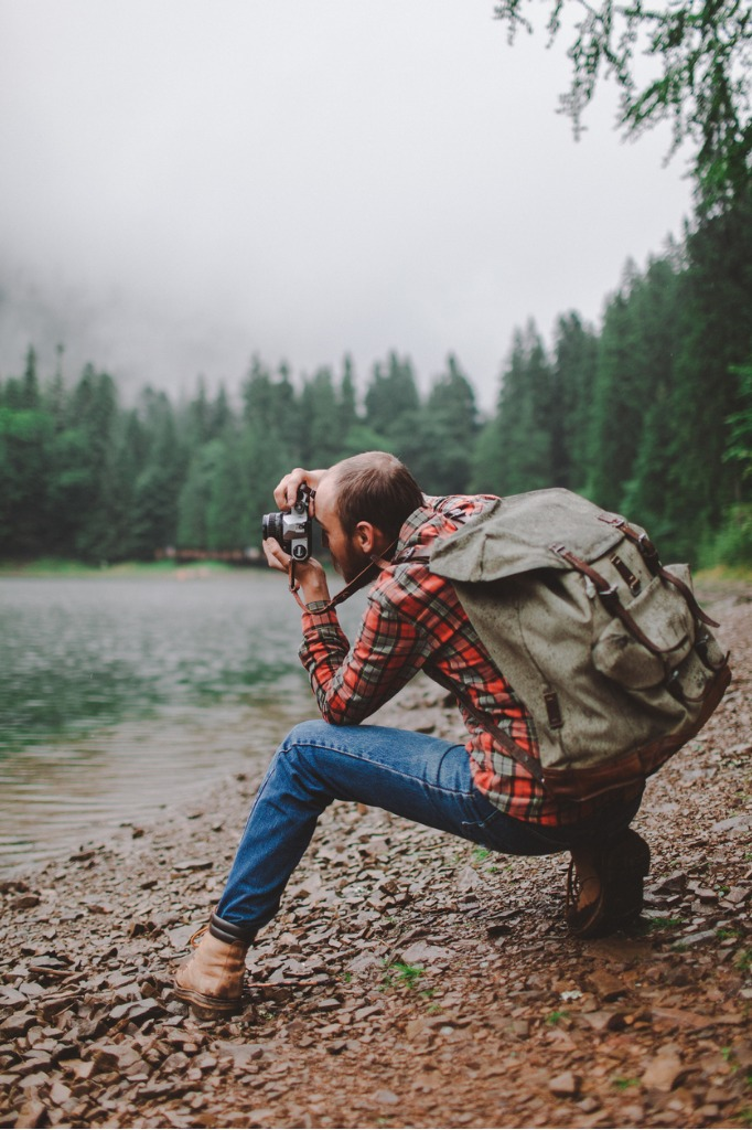 man taking photos with film camera near the lake picture id697228490 image