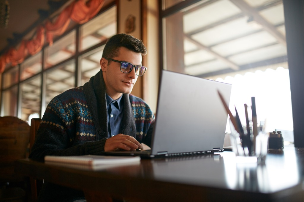 handsome freelancer businessman working on laptop in cafe blogger man picture id901296380 image