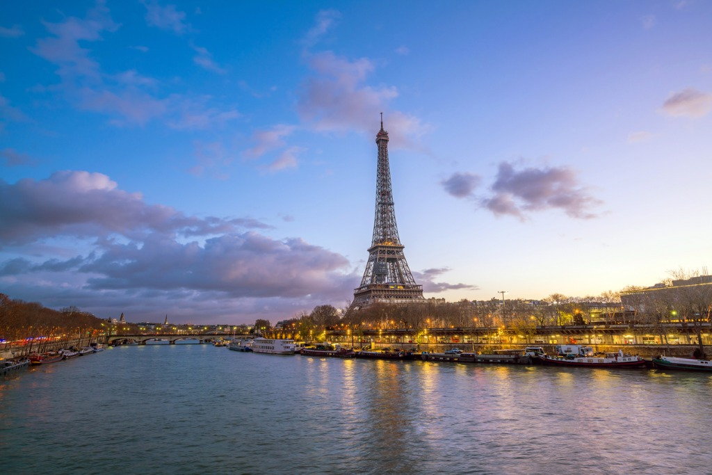 the eiffel tower and river seine at twilight in paris picture id944842038 image
