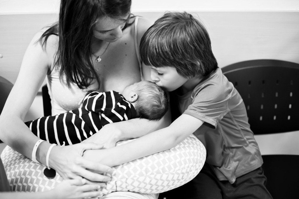 happy mother of three children after birth in hospital children new picture id888160928 image
