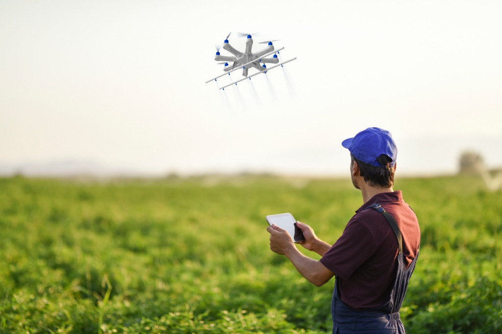 farmer spraying his crops using a drone picture id935726026