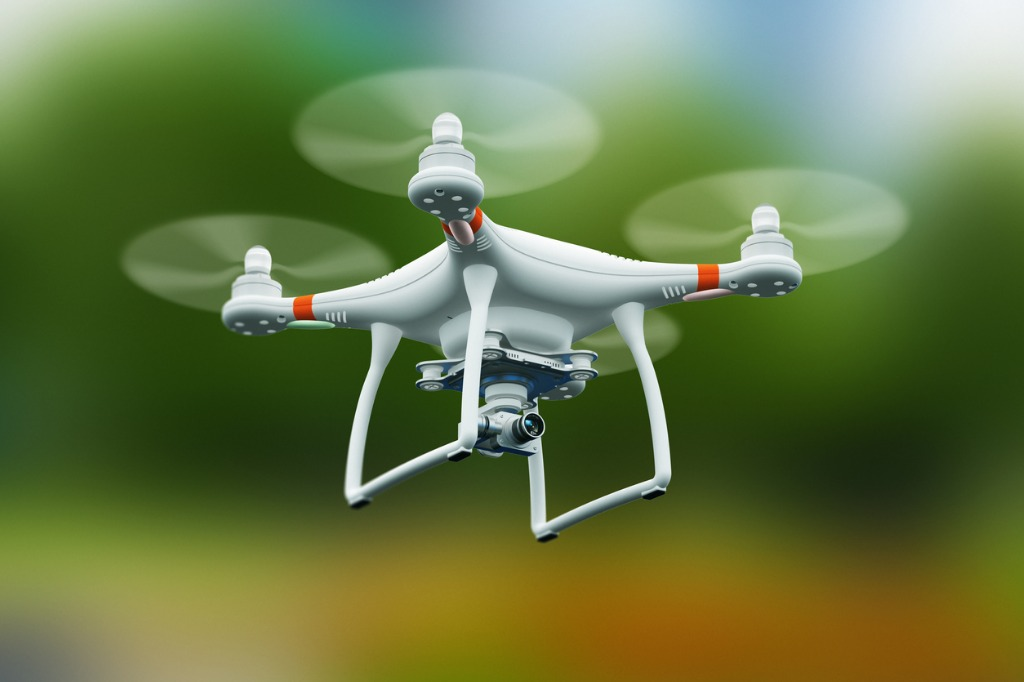 quadcopter drone with 4k video camera flying in the air picture id911190112