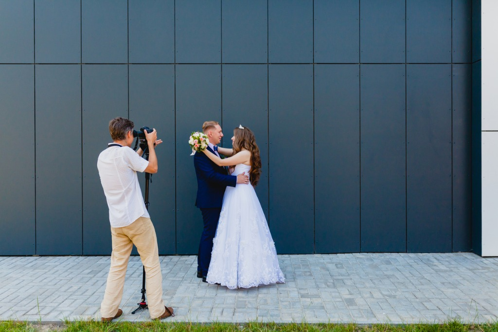 videographer with groom and bride picture id838421374 image