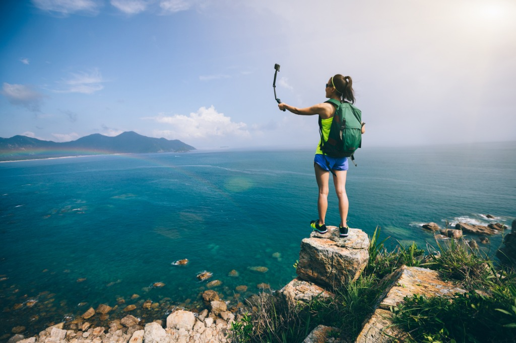 woman hiking in seaside taking a selfie picture id1018139110 image