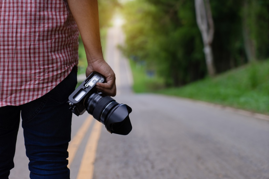 professional photographer hand holding dslr camera traveler people on picture id986656956 image