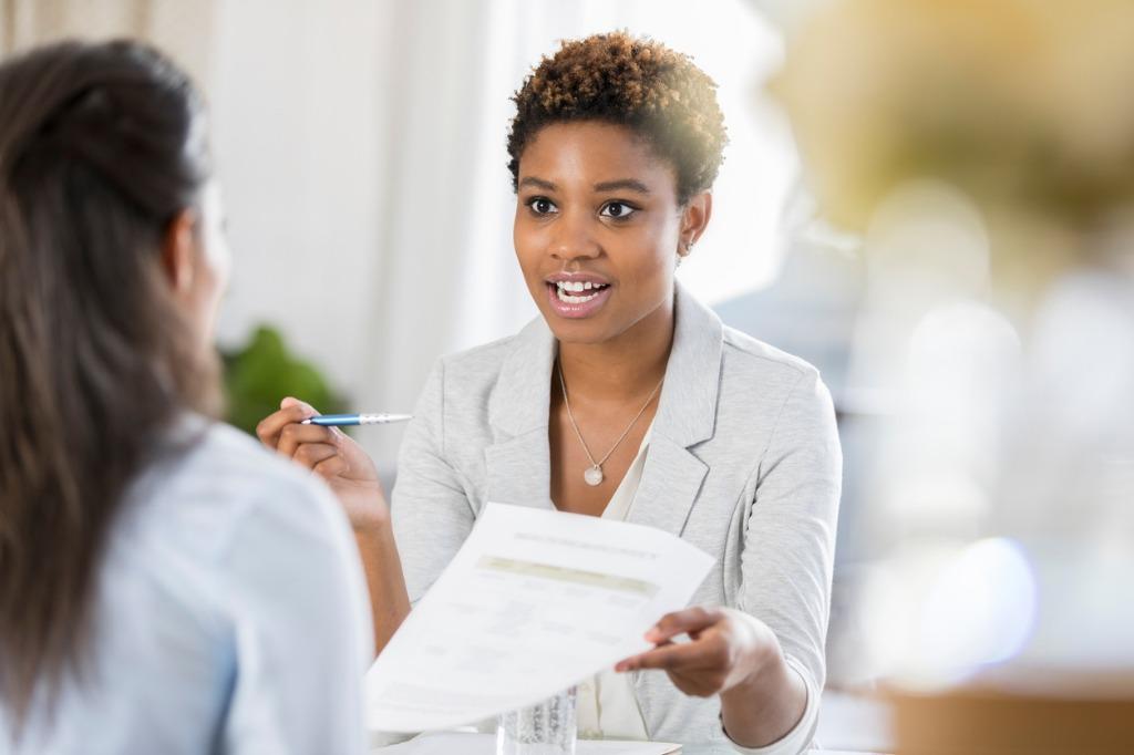 businesswomen meet to discuss document picture id865900230