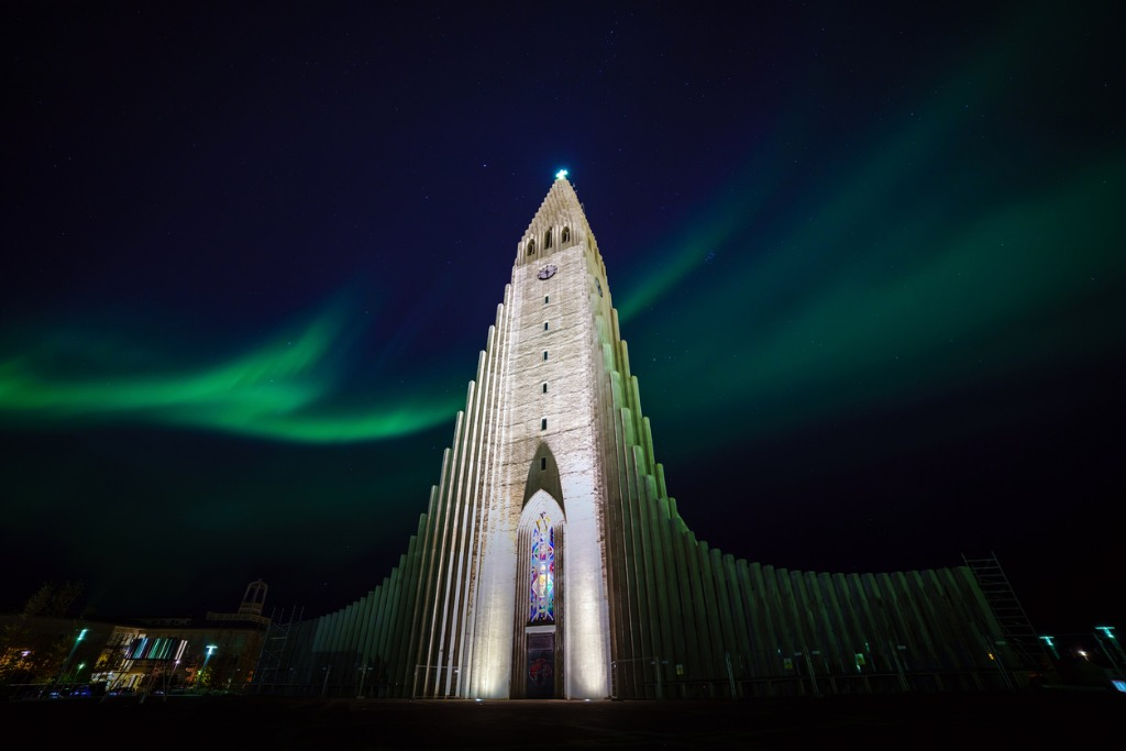 northern lights shining over the church in reykjavik picture id902340752 image