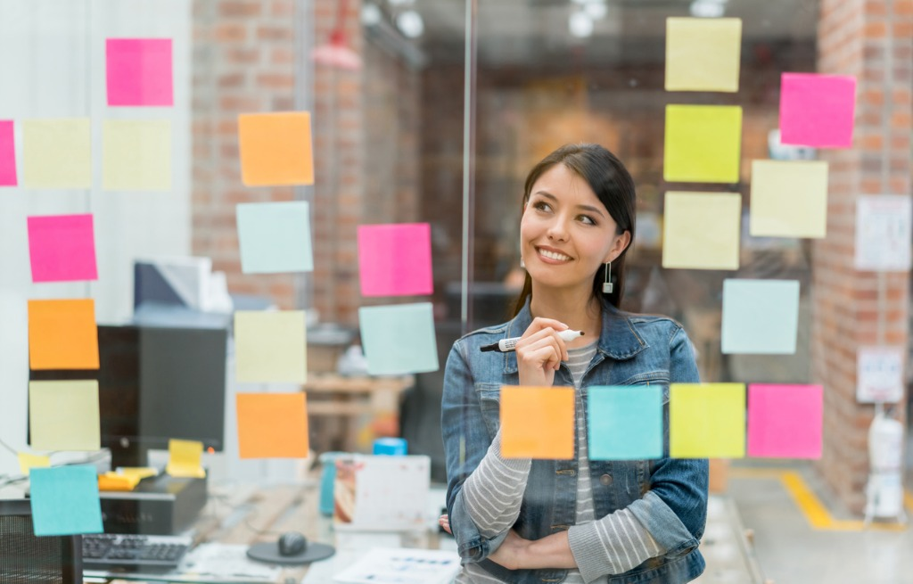 woman thinking of ideas at the office picture id525488514 image