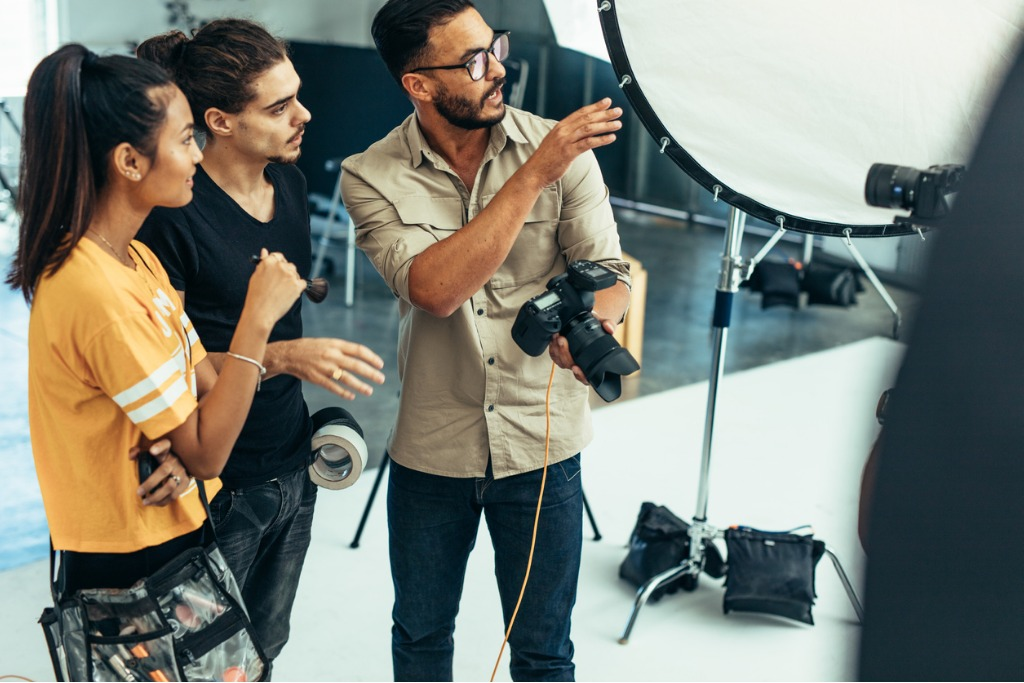 photographer working with his team during a photo shoot in a studio picture id1040613350 image