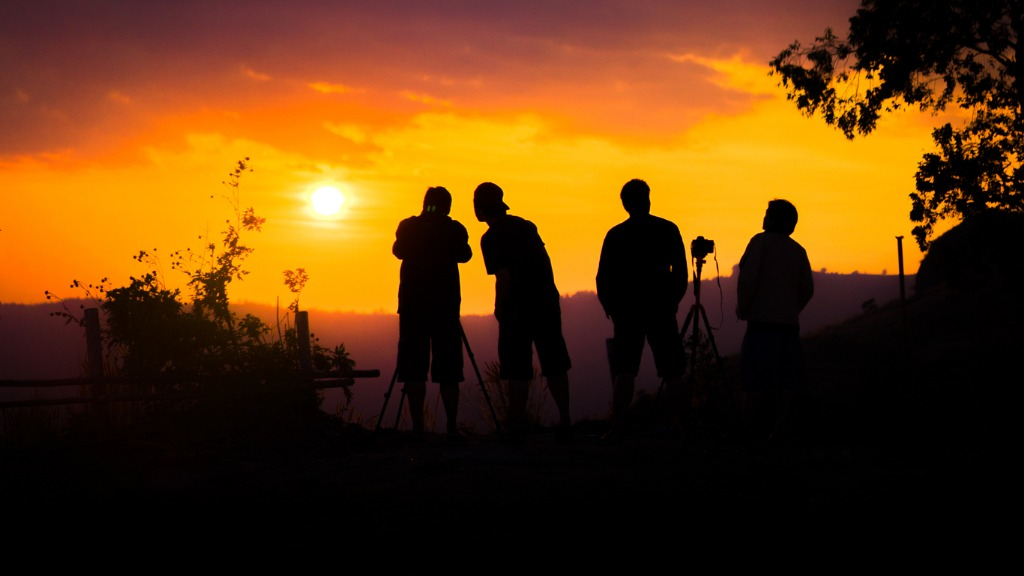 silhouette of group of friends standing and watching sunset on in picture id1034257884 image