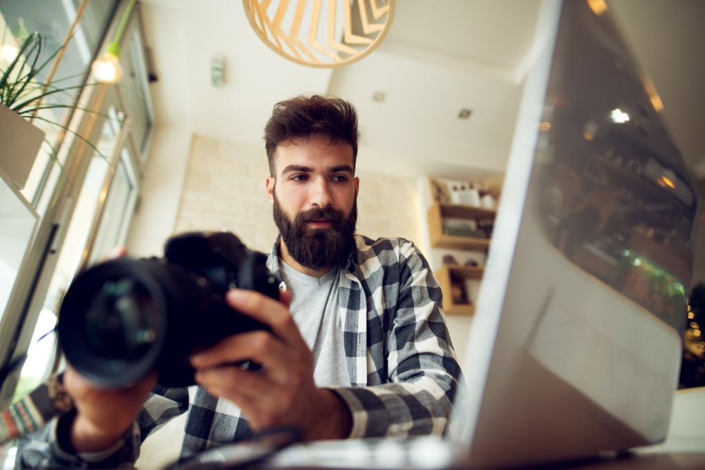 young photographer beard man editing pictures at his home picture id918321466 image