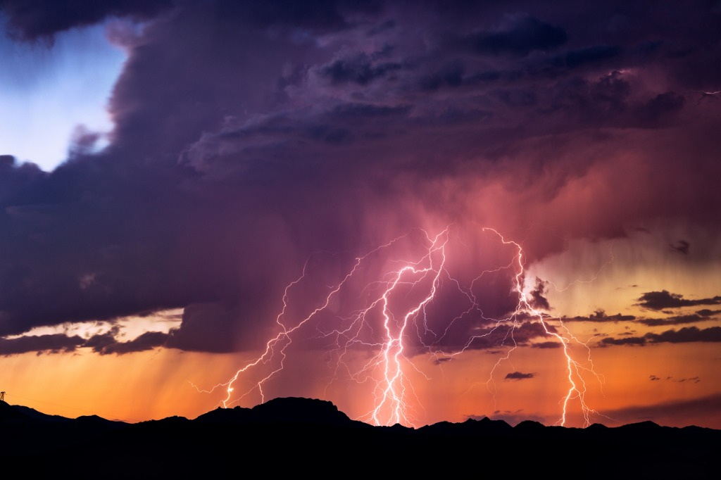 lightning bolts strike from a sunset storm picture id846469400 image