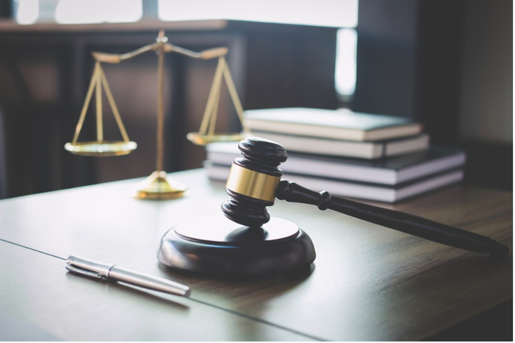 scales of justice and gavel on wooden table and lawyer or judge with picture id939262058 1