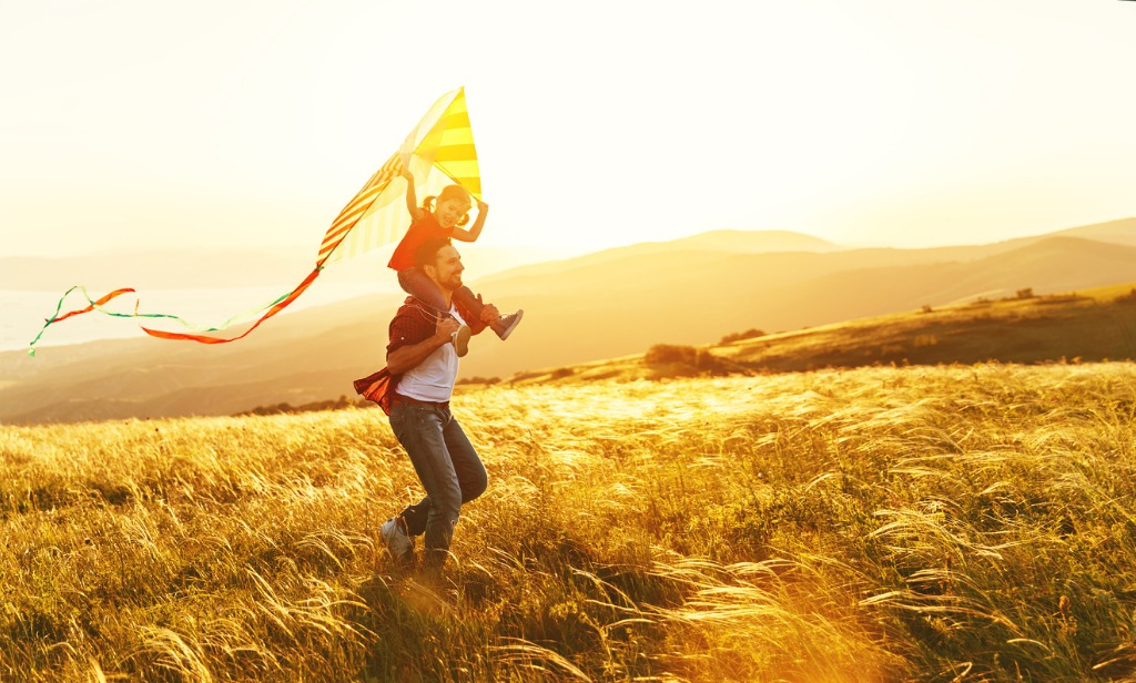 happy family father and child daughter run with kite on meadow picture id841348232 image