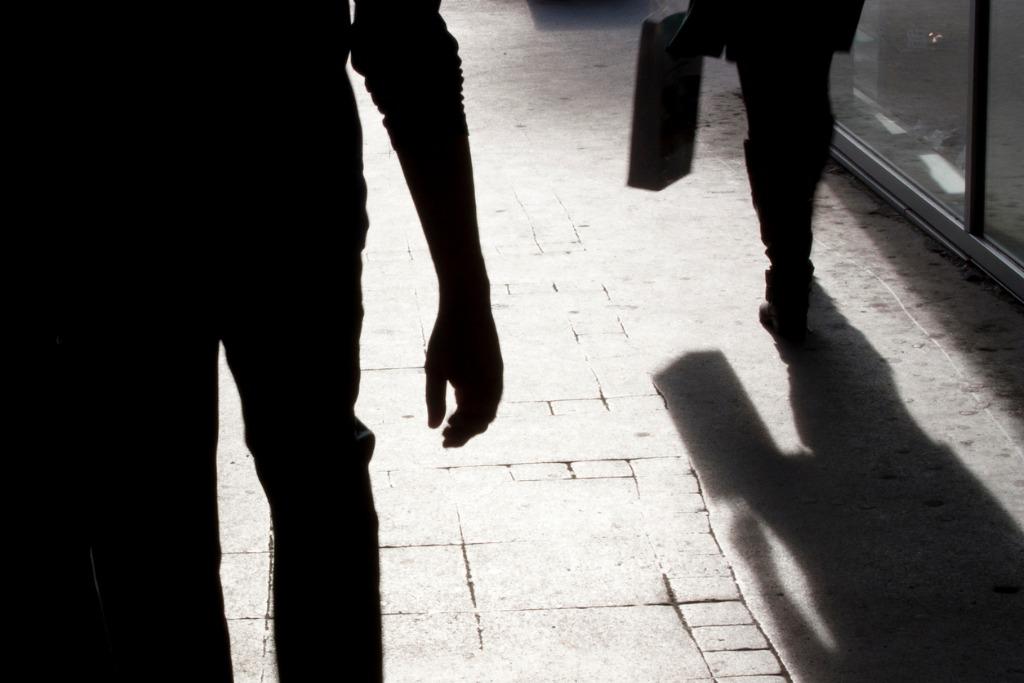 blurry silhouette and shadows of two person walking picture id847918186 image