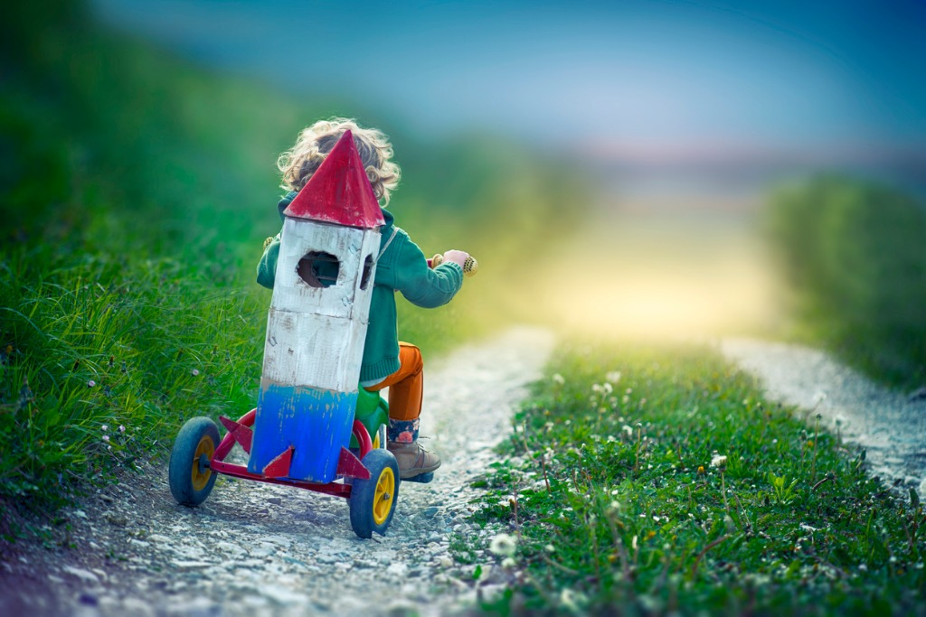 child with toy space rocket and tricycle picture id913705186 image