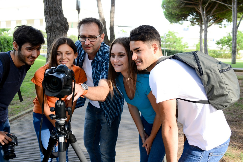 group young photography students with teacher during outdoor photo picture id595360182 image