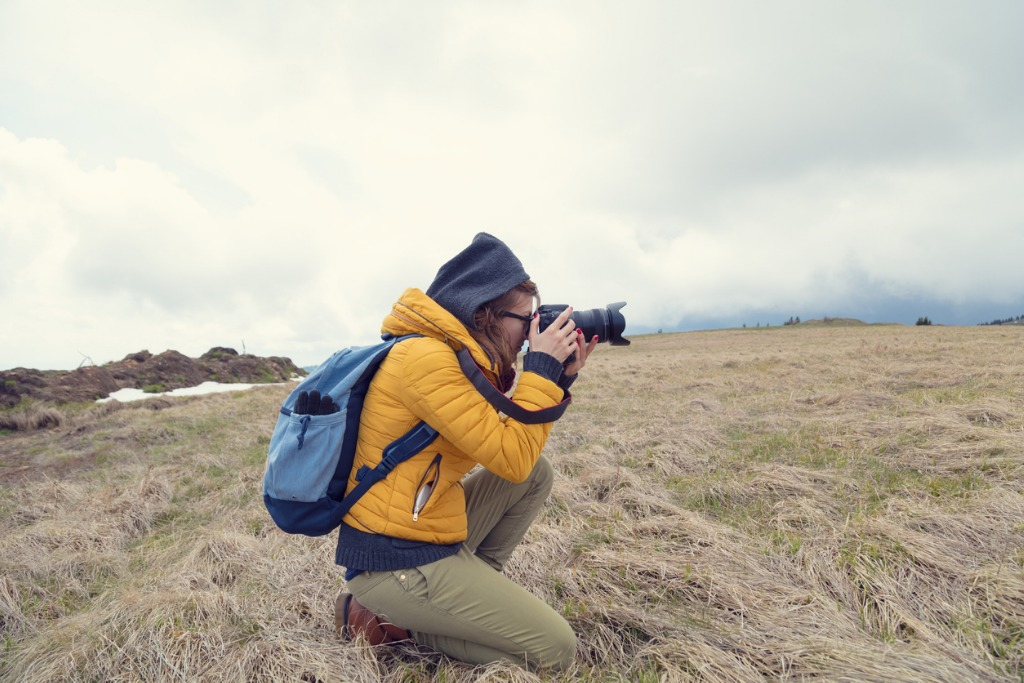 girl photographer shooting photos in nature field picture id853824160 image