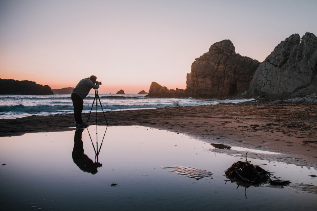 photographer with tripod at sunset picture id1045021568 image